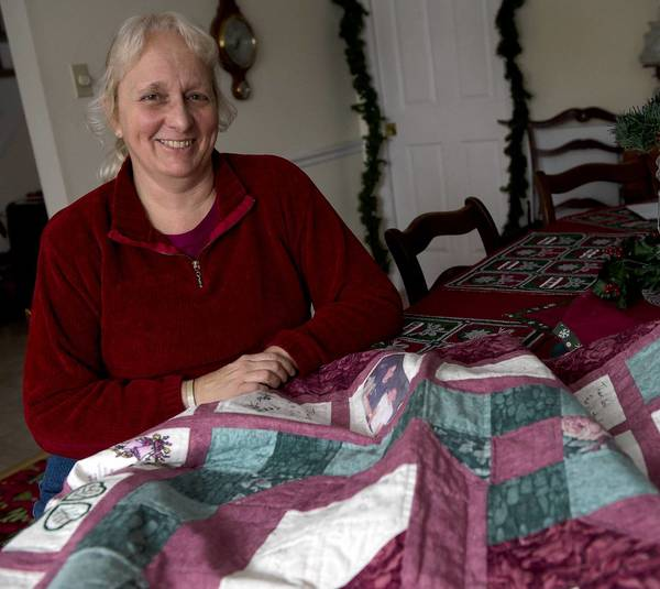 Janice Smith of South Whitehall Township with the 50th anniversary quilt for which she is trying to track down the family of the couple that it was made for.