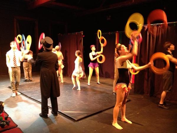 Traveling circus rehearses for Middnight On Main in Middletown.