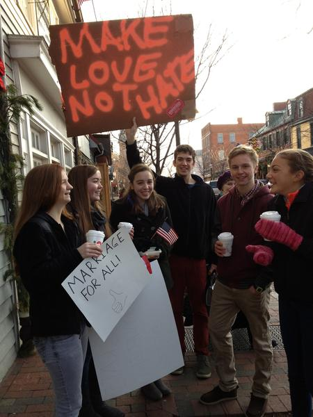 People with signs preaching tolerance countered protesters from the Westboro Baptist Church in Annapolis.