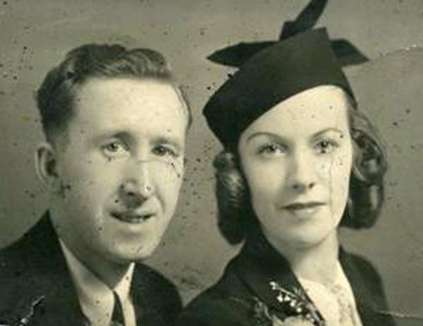 The wedding photo of Clifford and Leona Wharton. Clifford kept this snapshot in his tunic as he fought with the Royal Canadian Engineers in World War II. It shows damage from when he was killed trying to defuse a German anti-tank mine in Vorselaar, Belgium, on Oct. 21, 1944.