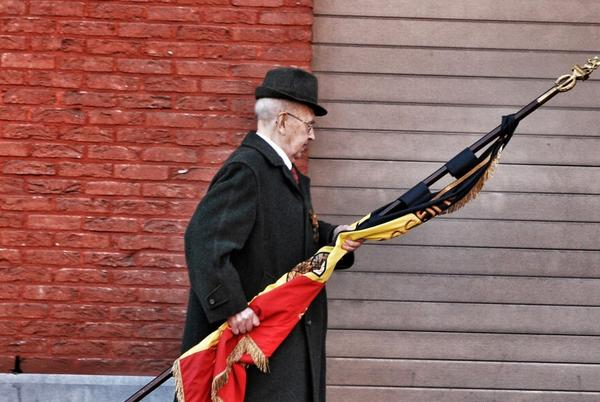Belgian World War II veteran August Smouts leaves a memorial for Clifford Wharton in Vorselaar in late November