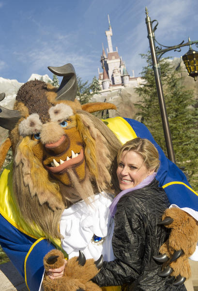 "Julie Bowen, one of the stars of ABC's ""Modern Family,"" waltzes with Beast from ""Beauty and the Beast"" in New Fantasyland at Magic Kingdom on Dec. 28, 2012."