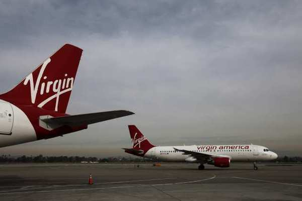 Virgin America was fined by the U.S. Department of Transportation for a delayed flight of more than two hours in Chicago.