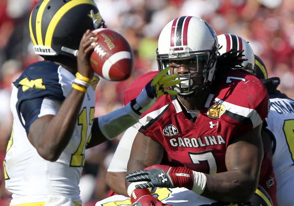 South Carolina Gamecocks defensive end Jadeveon Clowney (R) rushes as Michigan Wolverines quarterback Devin Gardner. South Carolina won the Outback Bowl 33-28.