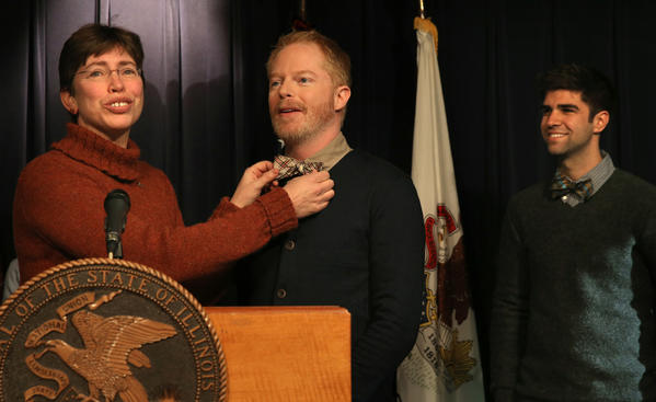 "Lt. Gov. Sheila Simon straightens the bow tie of Jesse Tyler Ferguson, of ABC's TV comedy ""Modern Family,""  as Ferguson's fiance, Justin Mikita, looks on at the Thompson Center Wednesday."