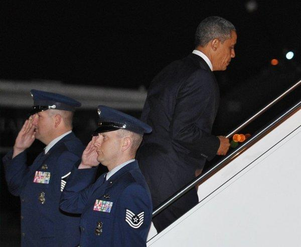 "President Obama boards Air Force One on Tuesday at Andrews Air Force Base in Maryland. He returned to Hawaii to continue his vacation which he interrupted to deal with the ""fiscal cliff"" crisis."