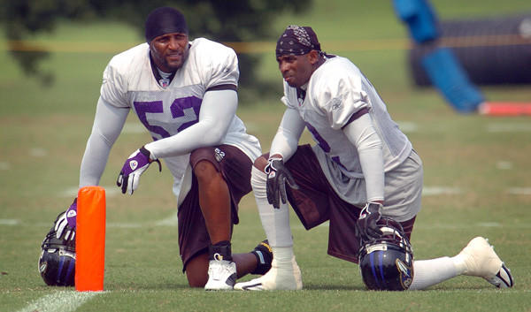 Ray Lewis and Deion Sanders take a break during training camp in 2005.