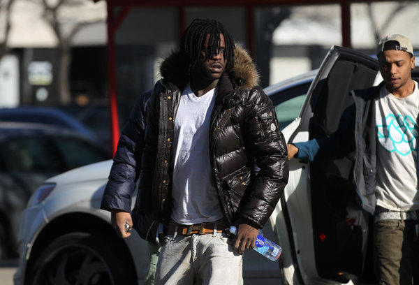 South Side rapper Chief Keef, whose real name is Keith Cozart, left, arrives at Juvenile court today for new allegations he violated his juvenile probation by moving to Northbrook without telling authorities. The court appearance was the latest legal trouble for Chief Keef who is on probation after a juvenile conviction for pointing a gun at a police officer.