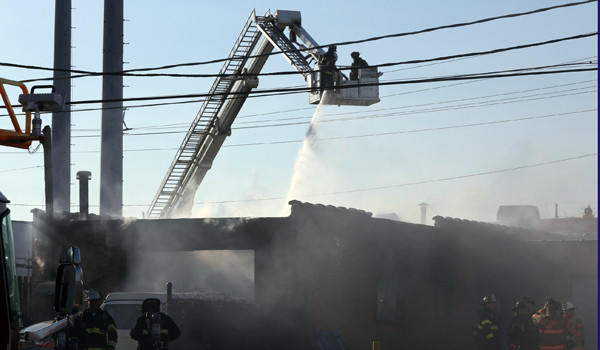 Firefighters from ten area fire departments responded to a 2-11 alarm fire at an auto body shop in an industrial area at 3305 Mannheim Road. Police said that the flames were so high that they caused three traffic accidents by motorists on the Mannheim overpass.