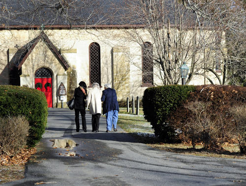 Parishoners make their way into St. George's Episcopal Church in Perryman on Sunday morning. Dec. 30, for the final service at the church.