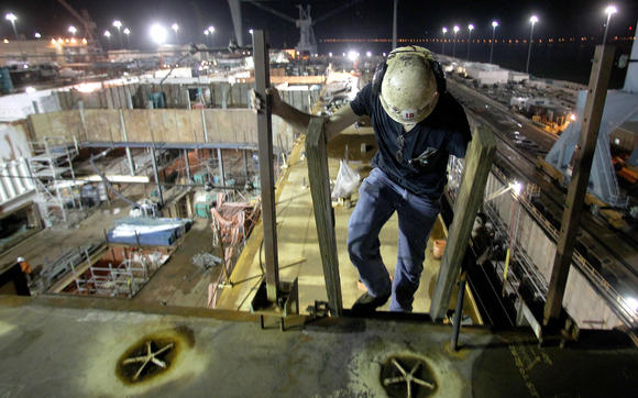 Short climbs down into the ship after making sure gas was flowing properly to his welding apparatus