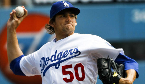 Pitcher Nathan Eovaldi was traded by the Dodgers to the Miami Marlins in a deal for infielder Hanley Ramirez.