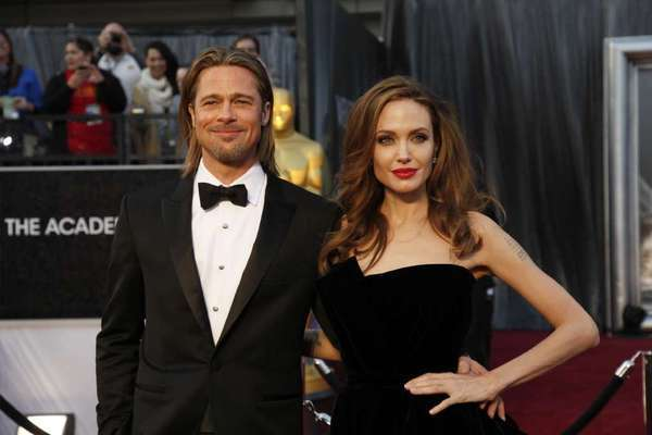 Brad Pitt and Angelina Jolie make their entrance during the 66th annual Golden Globe Awards in February 2012.