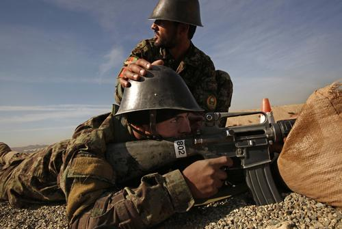 Azizullah, 20, below, in his fifth week at the Kabul Military Training Center, goes through a weapons exercise. Azizullah and his first cousin Rahmatullah, not shown, are among many in their family in the armed forces. Both were encouraged to join by their fathers and uncles, Pashtuns from a nearby hilltop village where support for Afghan security forces is strong and hatred of Taliban insurgents runs deep.