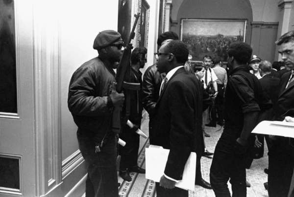 In May 1967, Black Panthers protesting an Assembly bill to ban openly carrying loaded weapons showed up at the state Capitol with unloaded firearms. That's a young Willie Brown, future Assembly speaker, talking with a Panther.