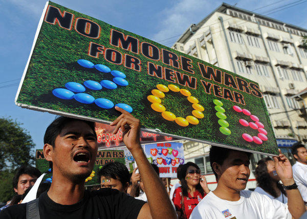 Demonstrators in Yangon, Myanmar, protest fighting between government forces and rebels.