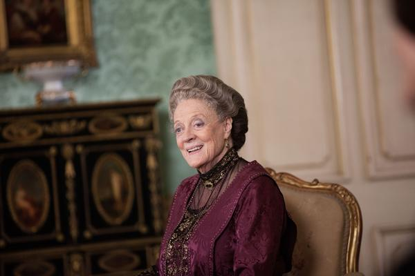 "Maggie Smith as Violet Crawley, Dowager Countess of Grantham, during filming of Season 3 of the hit period drama ""Downton Abbey."" Here's a look back at the British actress' lengthy career."