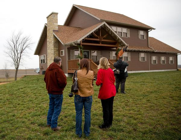 Potential buyers outside a house owned by Rita Crundwell, but occupied by a renter, Friday, Dec. 7, 2012. Alex Garcia/ Chicago Tribune
