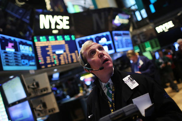 Traders work at the New York Stock Exchange on Jan. 2, a day after a last-minute agreement to avert the fiscal cliff. The market finished the day up more than 300 points.