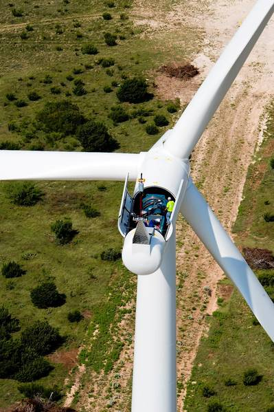 A Siemens Energy employee performs service work on the open nacelle of a giant wind turbine at the Buffalo Gap 3 wind farm near Abilene, Texas. The wind farm is owned by AES Corp., a large, independent power producer.