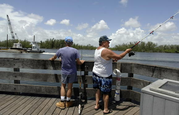 A couple of fishermen on the Dania Beach Pier take advantage of warm weather.
