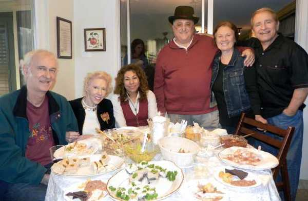 Among the 50 guests enjoying the Canada Crescenta Democratic Club's December holiday party were, from left, Bruce McBirney, Mary Naff, Lorena Abzun, Anthony Portantino, Greta Pruitt and Chuck Guinta. The event was held at the Guinta home in La Cañada.