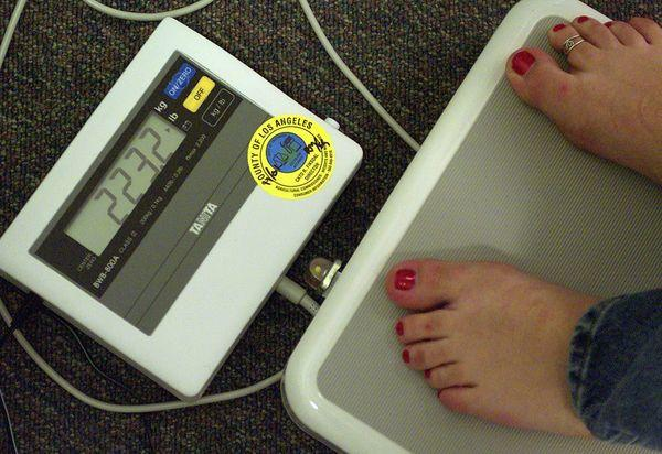 Weigh-in at a Weight Watchers meeting in Pasadena. 2013 brings new resolutions to shed pounds.