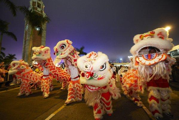 White lions dance for the crowd during the 2012 Chinese New Year Parade in Hong Kong.