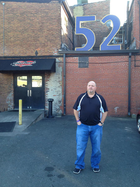 Dave Rather, owner of Mother's Federal Hill Grille, stands in front of the Ray Lewis' No. 52 that hangs over the bar in parking lot.