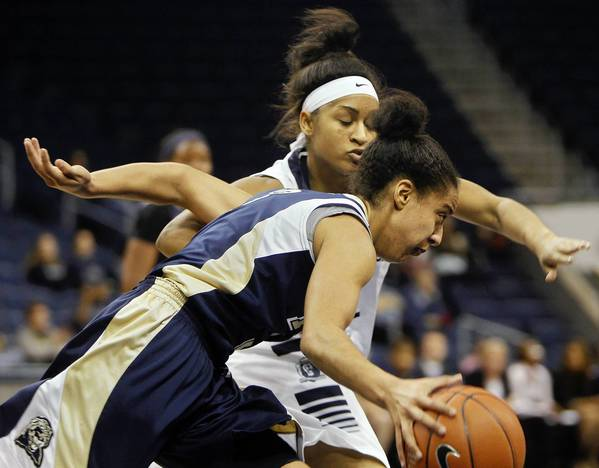 Kaitlin McKeown/Daily Press Photo Old Dominion's Ashley Betz-White puts full-court pressure on Pittsburgh's Brianna Kiesel during the second half of Wednesday's game.