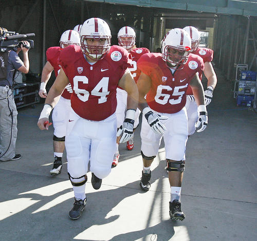 Stanford's Sam Schwartzstein and Khalil Wilkes run out of the tunnel onto the field to warm up before the game at the 99th Rose Bowl in Pasadena on Tuesday, January 1, 2013. Sanford beat Wisconsin 20-14 which was the third time in a row Wisconsin had lost the Rose Bowl, and Stanford ended a 40 year stretch since their last win.