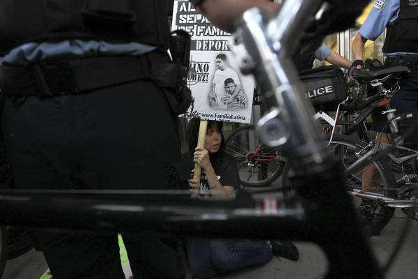 Chicago police arrest a protester during a demonstration against U.S. immigration policy last year.