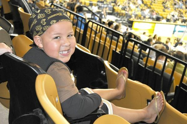 Marlie Dodson, 8, smiles at a UCF basketball game. Because she was such a Knights fan, her family is raising money for a nursing scholarship.