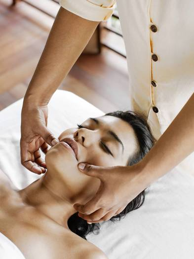 Woman receiving Marma Point Therapy