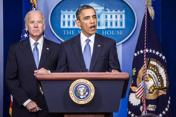 President Obama, right, speaks as Vice President  Joe Biden looks on in the Brady Press Briefing Room at the White House in Washington, D.C. The House of Representatives passed legislation averting income tax increases for most U.S. workers after Republicans abandoned their effort to attach spending cuts that would have been rejected by the Senate.