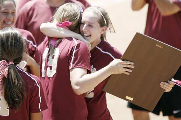 ARCHIVE PHOTO: La Canada's Lauren Cox, left, and Catherin Homer embrace each other after winning the CIF Southern Section Division V Championship against Beumont on June 2, 2012.