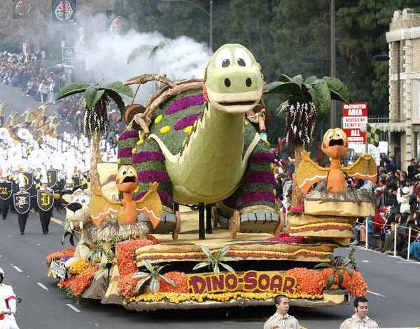 """""""Dino-Soar,"""" the float made by the La Canada Flintridge Tournament of Roses Assn., rolls down Colorado Boulevard during the 124th Rose Parade on Jan. 1, 2013."""
