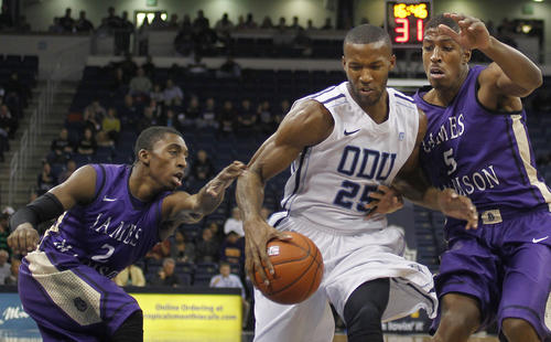 Old Dominion's Donte Hill drives past James Madison's Ron Curry and Alioune Diouf during the first half of Wednesday's game.