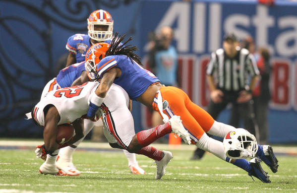 Florida Gators defensive back Josh Evans brings down Louisville running back Jeremy Wright at the Allstate Sugar Bowl game between the Florida Gators and the Louisville Cardinals at Mercedes-Benz Superdome on January 2, 2013 in New Orleans, Louisiana.