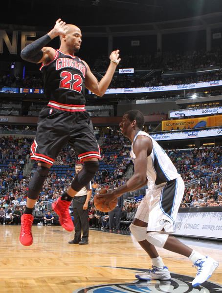 Chicago forward Taj Gibson (22) attempts to block the shot of Orlando forward Andrew Nicholson (44) during the first half of the Magic's game against the Bulls in Orlando, Fla.
