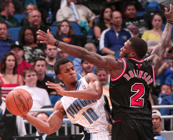 Chicago guard Nate Robinson (2) covers Orlando guard Ish Smith (10) along the baseline during the Bulls' 96-94 victory over the Magic in Orlando, Fla.