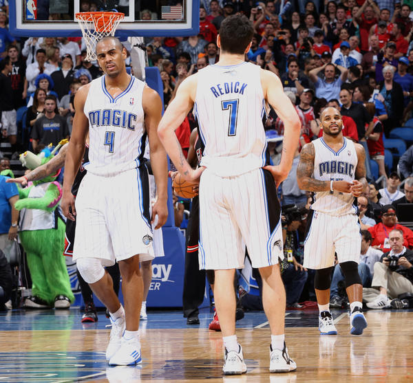 Orlando guards Arron Afflalo (4), J.J. Redick (7) and Jameer Nelson (14) react in the final seconds of the Magic's 96-94 loss to the Chicago Bulls in Orlando, Fla.