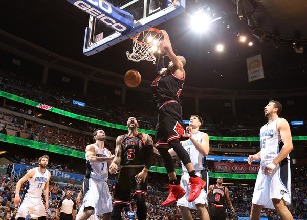 Chicago's Taj Gibson (22) dunks over Orlando's Nikola Vucevic (9) during the Magic's 96-94 loss to the Bulls in Orlando, Fla.
