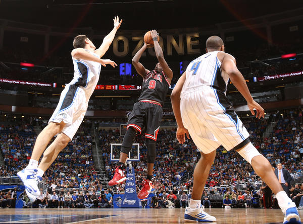 Chicago forward Luol Deng (9) shoots over Orlando center Nikola Vucevic (9) during the Bulls' 96-94 victory over the Magic in Orlando, Fla.