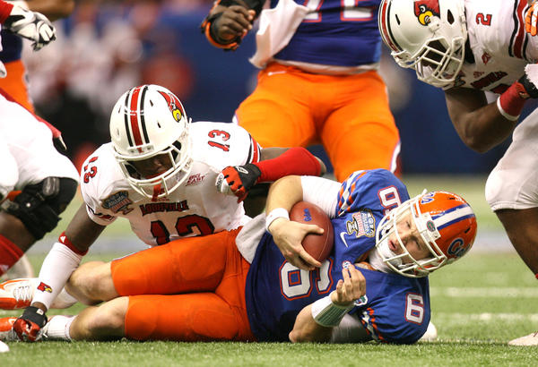 Florida Gators quarterback Jeff Driskel grimaces after being brought down by Louisville linebacker James Burgess during the Allstate Sugar Bowl game between the Florida Gators and the Louisville Cardinals at Mercedes-Benz Superdome on January 2, 2013 in New Orleans, Louisiana.