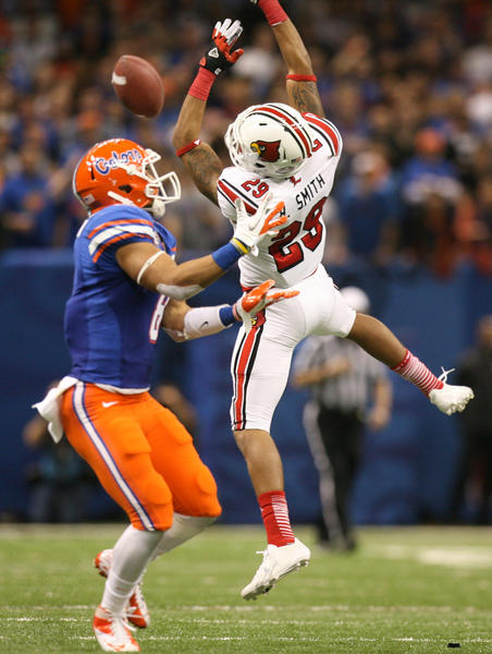 Louisville safety Hakeem Smith breaks up a pass intended for Florida's Trey Burton during the Allstate Sugar Bowl game between the Florida Gators and the Louisville Cardinals at Mercedes-Benz Superdome on January 2, 2013 in New Orleans, Louisiana.