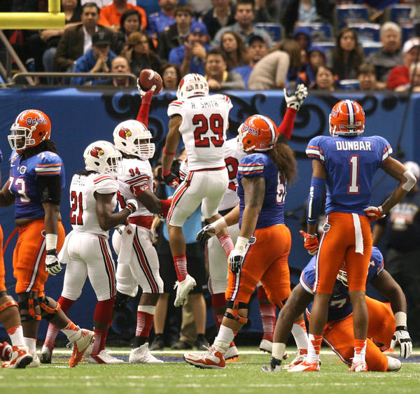 Louisville players react after recovering the ball on a Jeff Driskel fumble in the second half of the Allstate Sugar Bowl game between the Florida Gators and the Louisville Cardinals at Mercedes-Benz Superdome on January 2, 2013 in New Orleans, Louisiana.
