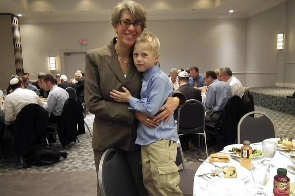 Rabbi Toby H. Manewith and her son.