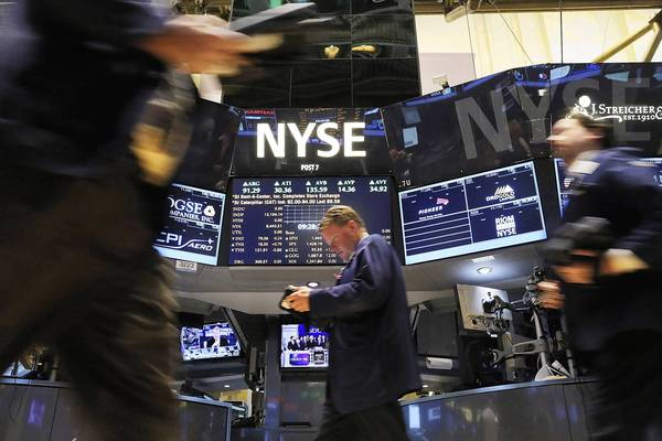 "Traders work Wednesday on the floor of the New York Stock Exchange. Stocks surged a day after U.S. lawmakers reached a last-minute agreement to avert the ""fiscal cliff,"" but more uncertainty looms in February."