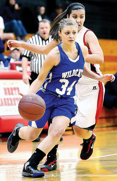 Williamsport's Erin Palmer (34) makes a move around the defense of North Hagerstown's Shelly Trumpower during the Hubs' victory.